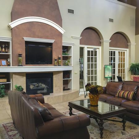 Community clubhouse from different angle, showing couches, coffee table, and the other side of the room.