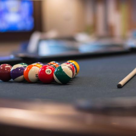Close up of pool balls racked up on pool table.