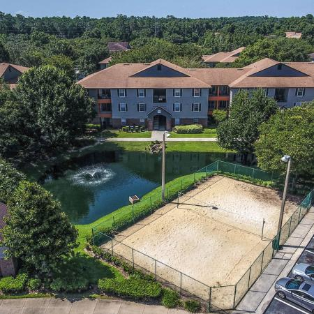 Lexington Crossing aerial view volleyball court next to small pond with fountain