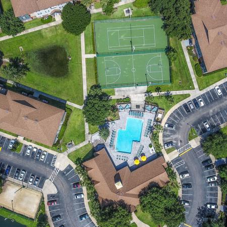 Lexington Crossing aerial view of property, buildings, swimming pool, basketball and tennis courts