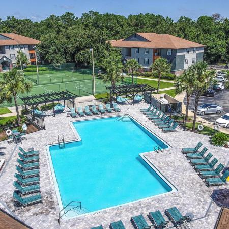 Lexington Crossing aerial view swimming pool with chairs and umbrellas