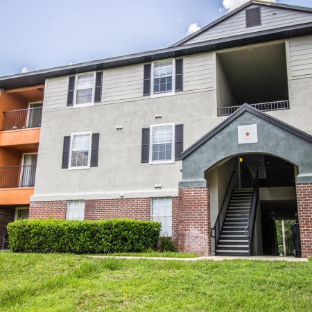 Lexington Crossing grass, shrubs, building exterior with balconies