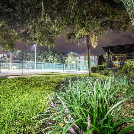 Lexington Crossing tennis courts at night, well lit