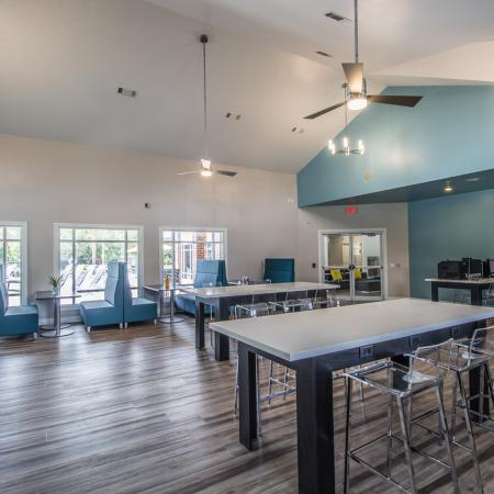 Lexington Crossing clubhouse with restaurant style seating, hardwood floors and ceiling fans