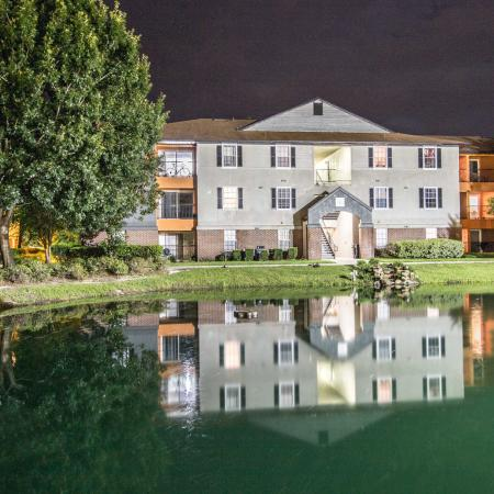 Lexington Crossing at night, pond in front of building exterior