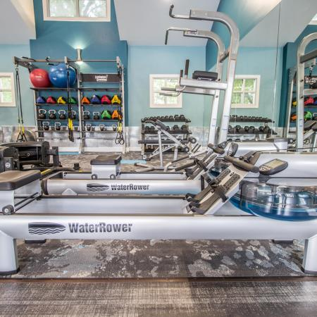 Lexington Crossing fitness center with rowing machines and free weights