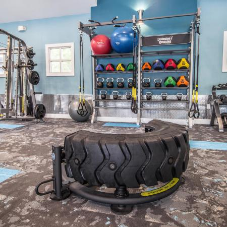 Lexington Crossing fitness center with free weights and power lifting rack