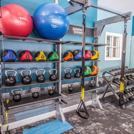 Lexington Crossing fitness center with free weights and yoga balls