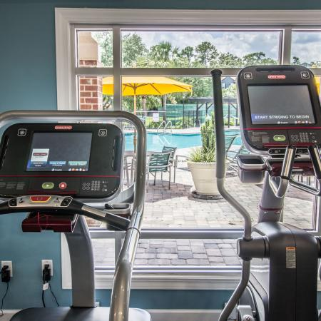 Lexington Crossing fitness center with treadmills and view out the window.