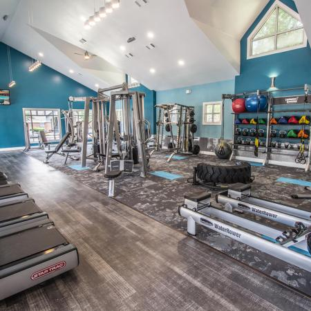 Lexington Crossing fitness center with rowing machines, pull down stations  free weights