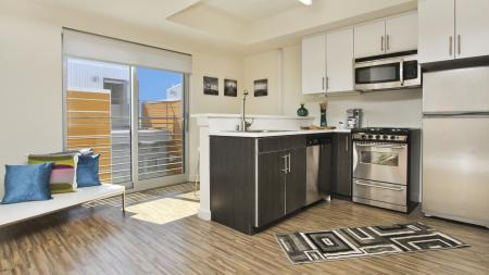 Kitchens with stainless steel appliances and utilities and finishes, apartments, Microwave, Stainless Steel, Stove, Oven, Counter, Stool