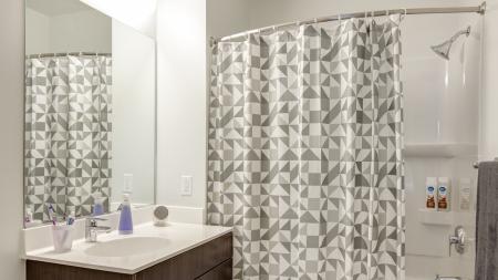 Spacious, large, luxury, modern bathroom with tile flooring