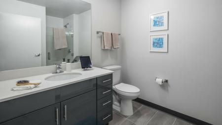 Spacious, large, modern bathroom with tile flooring