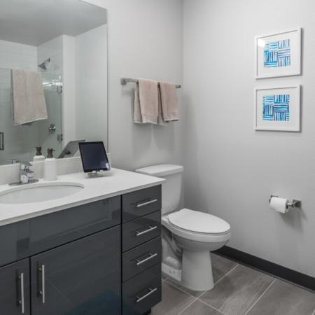 Spacious, large, modern bathroom with tile flooring