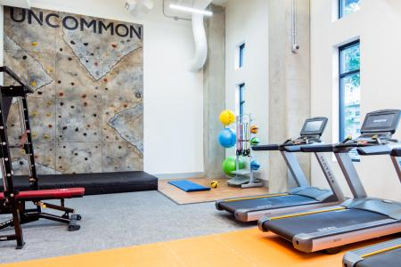 Residents Working Out at Fitness Center | Fort Collins Colorado Apartments | Uncommon Fort Collins