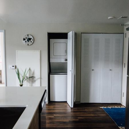 kitchen, countertops, stainless-steel appliances, in-unit washer and dryer,