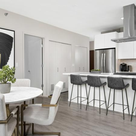kitchen, luxury, apartment, bar stools, counertops, island hood, stainless-steel appliances