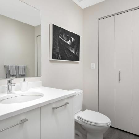 toilet, his and her sink, restroom, bathroom, quartz countertops, soft close cabinetry, italian finishes