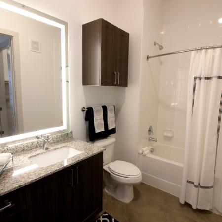Modern Dallas Apartments | Master Bathroom with Soaking Tub and Backlit LED Mirrors in our Dallas Texas apartments.(B2)