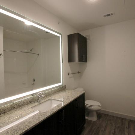 Modern Dallas Apartments | Bathroom with LED Back-lit Mirror at our Dallas Texas Apartments.(A3)