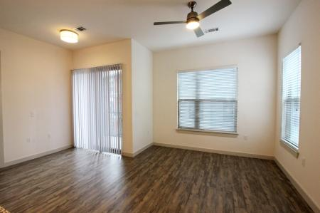Modern Dallas Apartments | Our Dallas Texas Apartments featuring beautiful interior designs. You'll love the wood flooring in the living room and private balcony (A3 Floorplan)