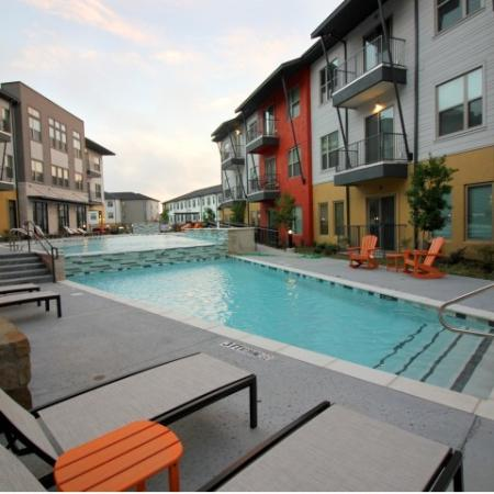 Modern Dallas Apartments | Resort style sparkling pool located at our Dallas Texas apartments.