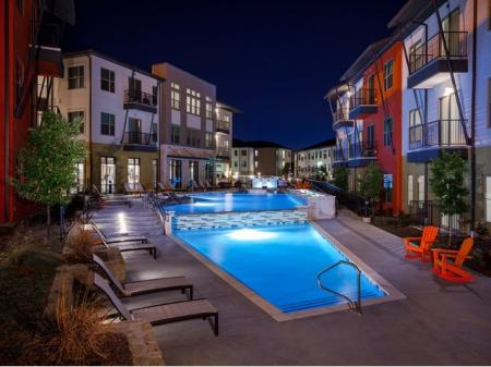 Modern Dallas Apartments | Sparkling pool at our LBJ Station Ltd Dallas TX apartments.