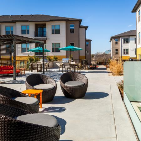 Modern Dallas Apartments | Outdoor seating at our Dallas Texas Apartments.