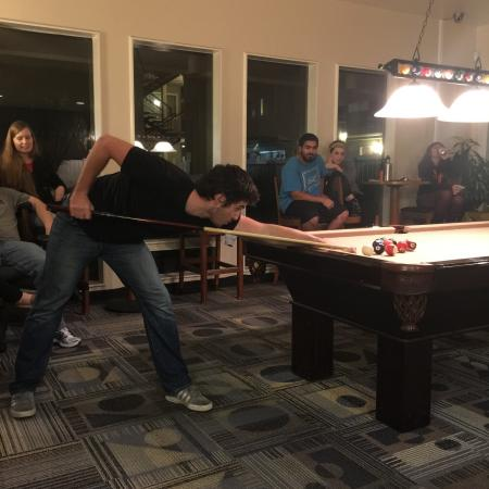 Residents Playing Billiards   Davis California Apartments for Rent   University Court