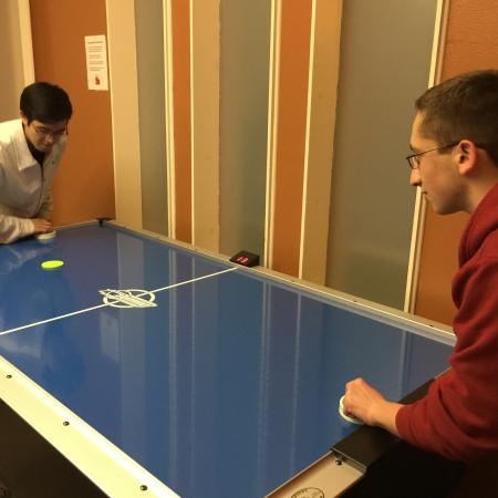Residents Playing Air Hockey   Apartments in Davis   University Court