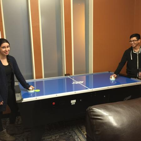 Residents Playing Air Hockey   Davis California Apartments for Rent   University Court