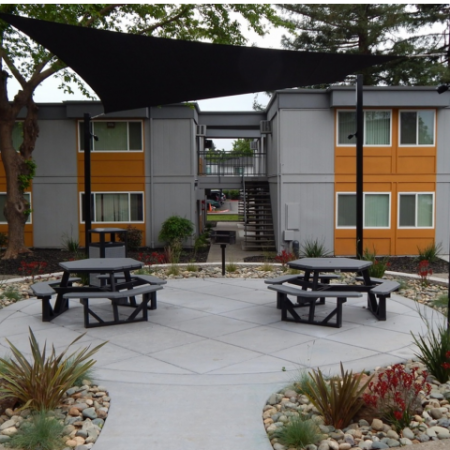 Residents Tanning on the Sun Deck | Apartments Near Sacramento State | University Village