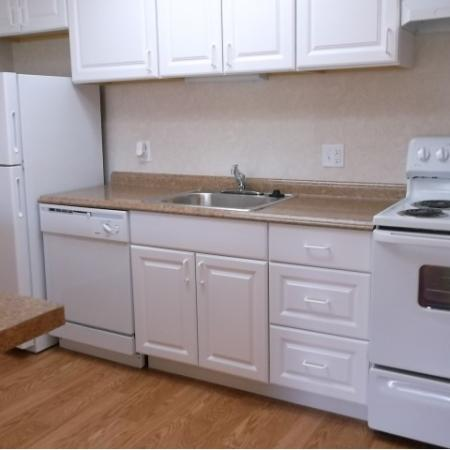 Beach Bluff Apartments, interior, kitchen, white cabinets and appliances, refrigerator, stove/oven, wood floor