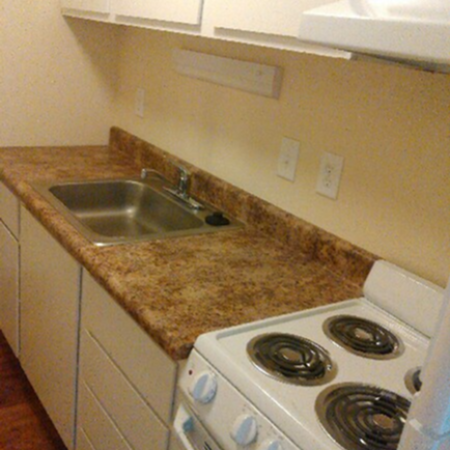 Palatka Oaks Apartments, interior, kitchen, white cabinets and appliances, stove/oven, wood floor