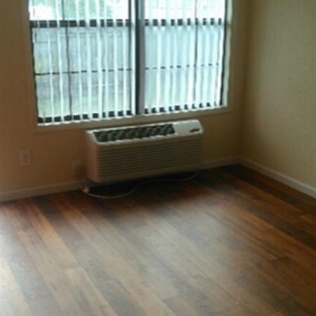 Palatka Oaks Apartments, interior, living room, wood floor, window, wall AC, front door