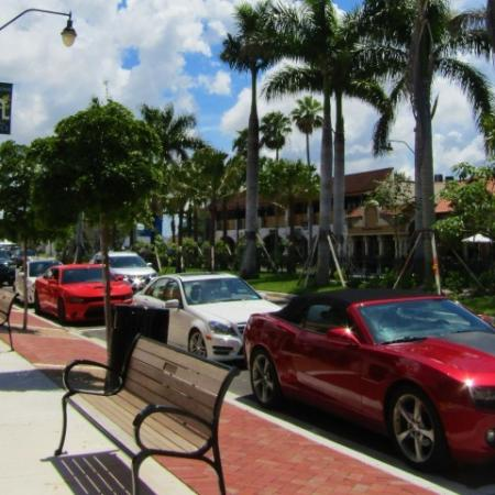 Clubside Apartment Homes, exterior, sidewalk, bench, cars, palm trees, building