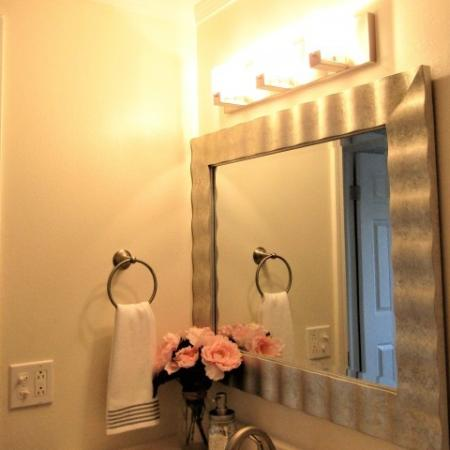 Clubside Apartment Homes, interior, bathroom, mirror, lights, towel rack, flowers