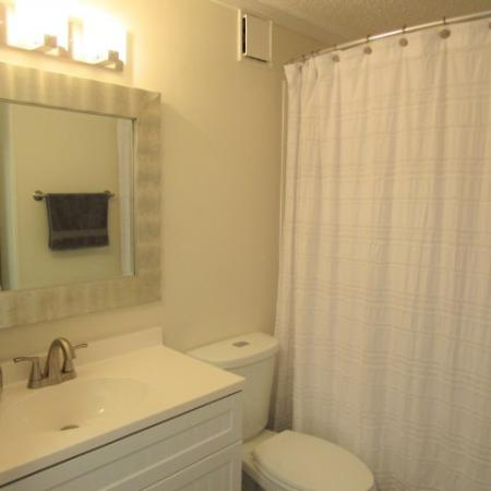 Clubside Apartment Homes, interior, bathroom, shower, toilet, sink, counter, all white