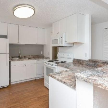 Bentwood Apartments, interior, living room, carpeted, kitchen, wood floor, doorways, white cabinets and appliances, refrigerator, stove/oven, dishwasher, peninsula counter
