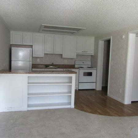 Bentwood Apartments, interior, kitchen, wood floor, white cabinets and appliances, refrigerator, stove/oven, dishwasher, peninsula counter
