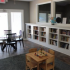 Clubhouse area: peaceful seating, children activities, books, Large windows and doors.