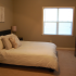 The Commons Sunpark: interior bedroom, beige carpet, window for natural light