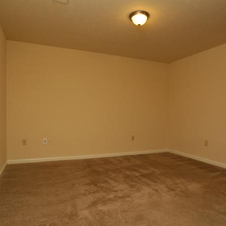 Cameron Crossing: brown carpet, white door, white baseboards