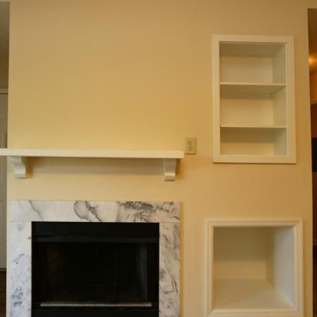 Cameron Crossing: interior, fireplace with marble surround, white shelf inserts