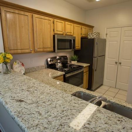 Residents Snacking in the Kitchen | Apartment Homes In Williamsville | Renaissance Place Apartments