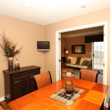 Residents Having Dinner in the Dining Room | Apartment Homes In Williamsville | StoneGate Apartment Homes