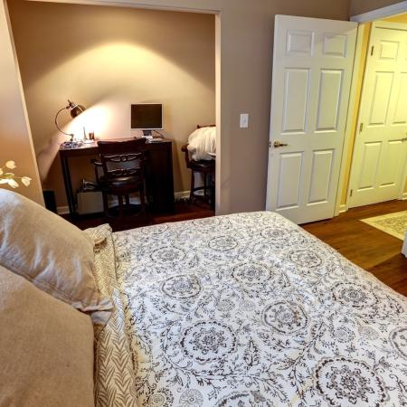 Master Bedroom Suite with a Reading Nook at Apartment Home Rentals in Williamsville | StoneGate Apartment Homes