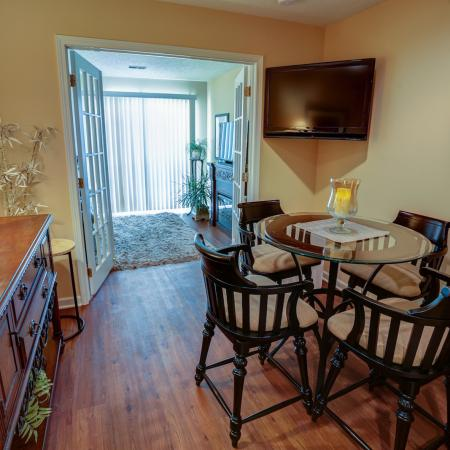 Spacious Dining with Wood Plank Floors at Apartment Homes in Williamsville NY | StoneGate Apartment Homes