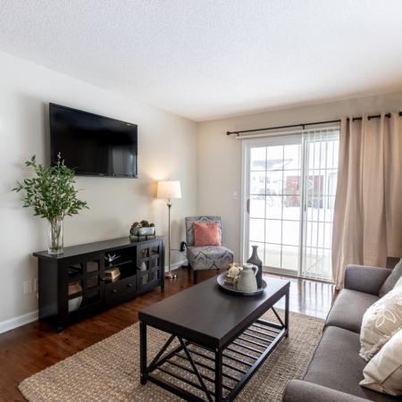 Residents Lounging in the Living Area | Amherst Apartments | Autumn Creek Apartments