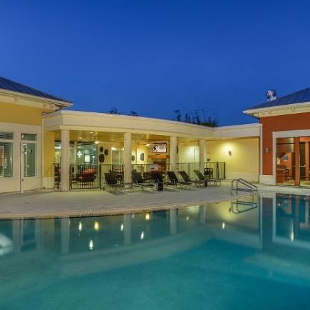 Residents Lounging by the Pool | Studio Apartments For Rent In Orlando |